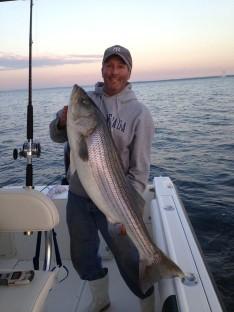 "Capt. Skip with a 48"" 44 lb. Bass"