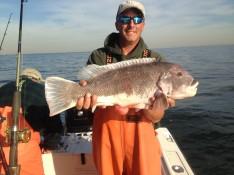 Capt. Skip with an 11lb. 3 oz. Big Tog